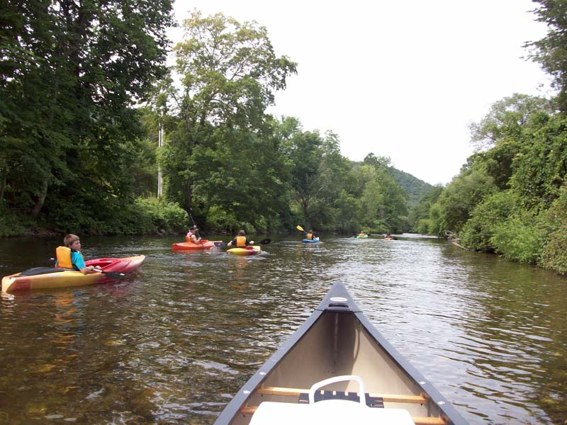 Canoe and kaykers on river