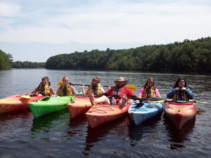 Group on kayaks on river